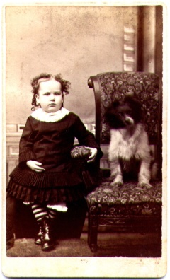Girl Seated Beside Dog