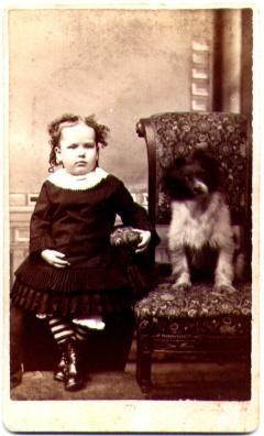 Girl Seated Beside Dog